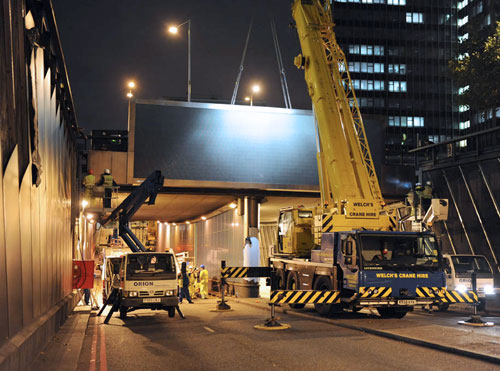 Photo of SIS Digital installing one of the two large format digital LED screens on the Euston Road Underpass in London