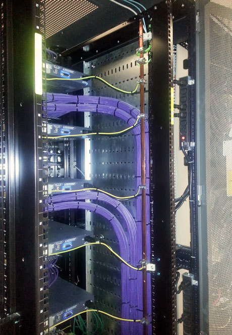 Photo showing an extremely tidy network/telecoms infrastructure installation by SIS Digital Networks