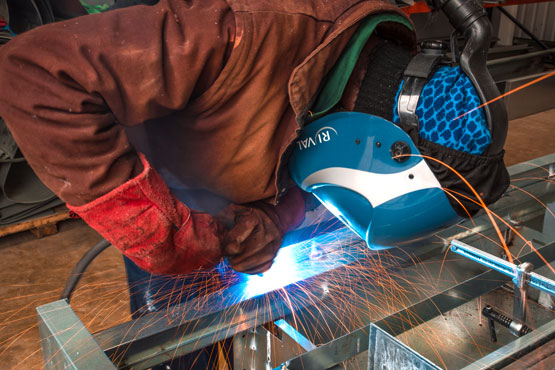 Photo of an engineer welding steel fdigital signage components at SIS Digital's Vision Park factory